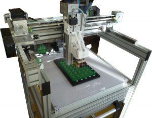 Testovací stroj pro plošné spoje